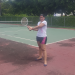 at El Salvador trying to play tennis.