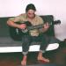 Playing guitard in Antigua