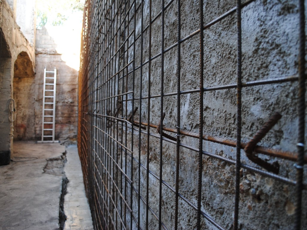 Rebar has been attached to the old wall